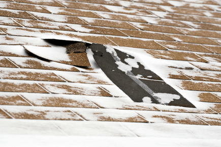 roof damaged by snow